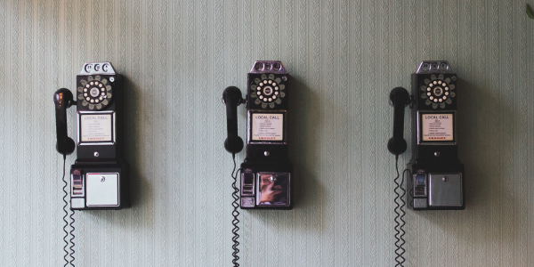 three rotary telephones